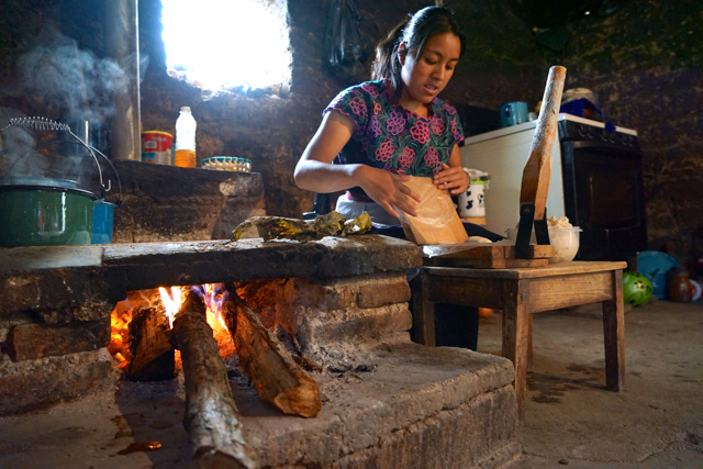 At home of one of the Chamuchic weaver. She's cooking some tortillas.