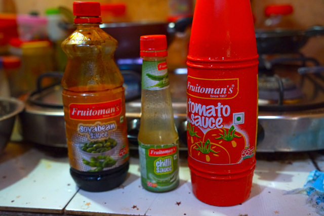 Add these sauces: a table spoon of soya sauce, a table spoon of green chili pepper sauce and as much of tomato sauce as you want.