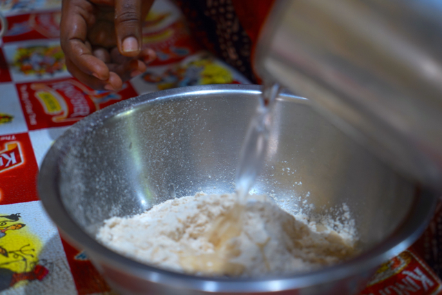 Start adding Hot water little by little to make a dough